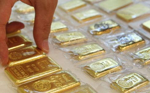 Gold climbed to a record in New York and London