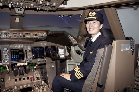 First Officer Sophia Kuo inside the cockpit of an EVA Airways Boeing 747