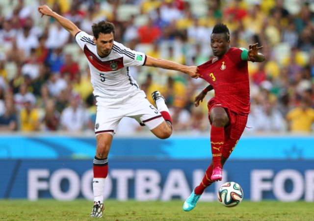 Asamoah Gyan, dragged back by Germany and dragged down by scandal.