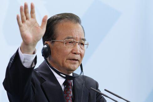 Wen Says World Must Cut Debt, Stem Euro Crisis as Pressure G