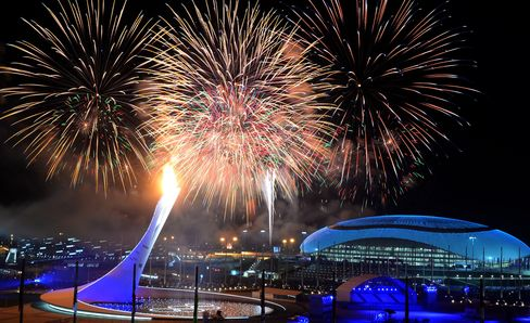 Fireworks light the sky over the Fisht Olympic Stadium as the Olympic flame is lit at the end of the Opening Ceremony of the 2014 Sochi Winter Oly