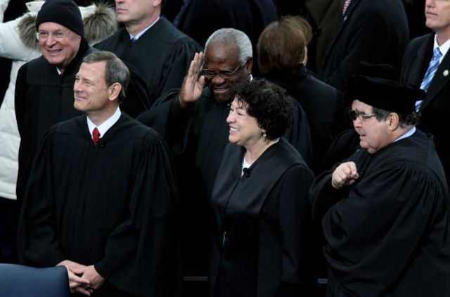 Clarence Thomas raising his corruption shield? Photographer: John Moore/Getty Images