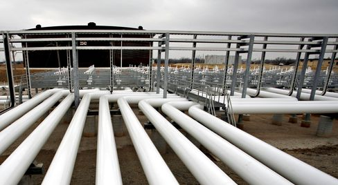 Oil Pipelines Feed into Storage Tanks