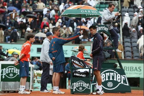 French Open Final Delayed by Rain as Nadal Leads Djokovic