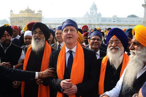 Cameron Says Aid Funding May Be Diverted Toward Defense Budget