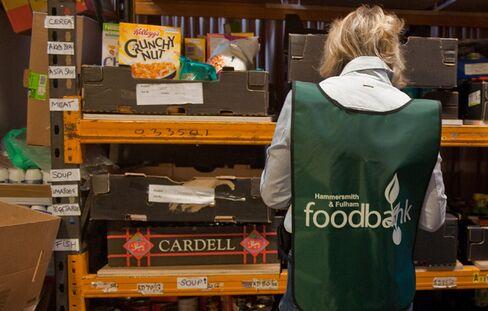 Volunteer Sorts Food at Food Bank