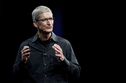 In Chief Executive Officer Tim Cook's first 16 months on the job, Apple has released next-generation iPhones and iPads and seen its stock price rise 43 percent. Photographer: David Paul Morris/Bloomberg