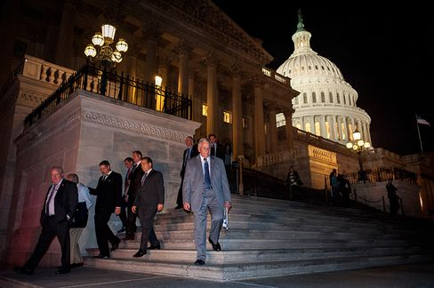 Members of the House of Representatives leave the U.S. Capitol in Washington, D.C., U.S., on Wednesday, Oct. 16, 2013. The U.S. Congress voted to halt the 16-day government shutdown and raise the U.S. debt limit, ending the nation's fiscal impasse. Photographer: Pete Marovich/Bloomberg