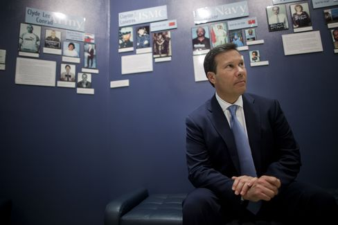 Frank Figliuzzi, assistant director for counterintelligence with the Federal Bureau of Investigation (FBI), sits for a photograph in front of a wall of convicted spy profiles at the FBI headquarters in Washington, D.C., on March 29, 2012. Photographer: Andrew Harrer/Bloomberg