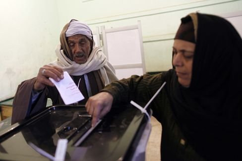 Egyptians Back Constitution as Secular Opponents Dispute Results