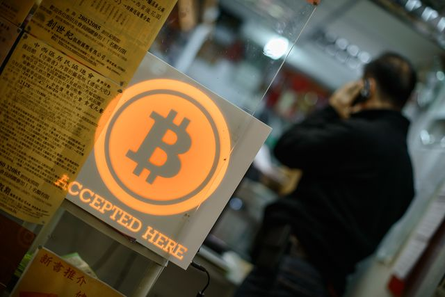 Will Bitcoins still be fun if you have to pay taxes on them? Photographer: Philippe Lopez/AFP/Getty Images