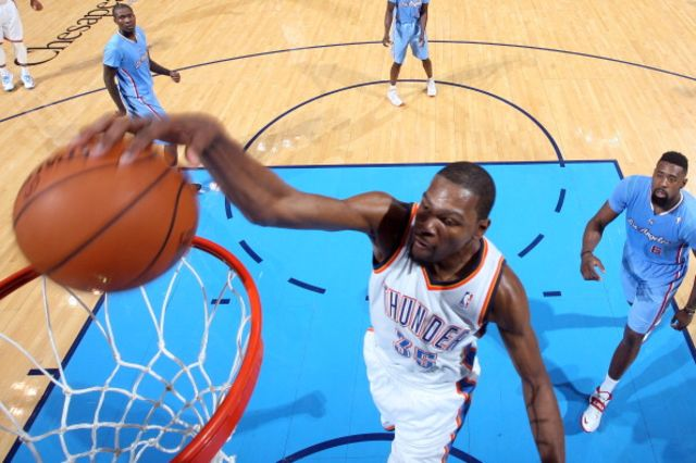 Basket by Durant, assist from the heavenly father? Photographer: Layne Murdoch/NBAE via Getty Images