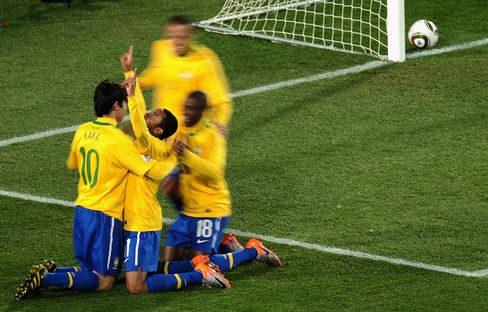 Robinho of Brazil celebrates scoring