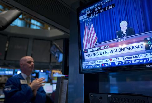 A Trader at NYSE Watches Janet Yellen on Television