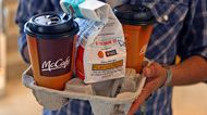 McCafe cups and a bag of food at a McDonald's restaurant in Oak Brook, Illinois.