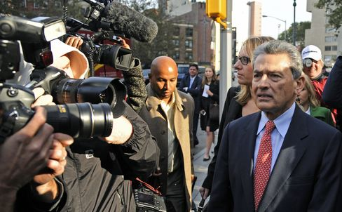 Rajat Gupta, former Goldman Sachs Inc. director and former senior partner at McKinsey & Co., right, exits federal court in New York, U.S., on Wednesday, Oct. 26, 2011. Gupta was indicted for conspiracy and securities fraud, making him the highest-ranking executive charged in a nationwide crackdown on insider trading centered on Raj Rajaratnam, co-founder of hedge fund Galleon Group LLC. Photographer: Peter Foley/Bloomberg
