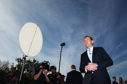 Tony Abbott Arrives at a Polling Station