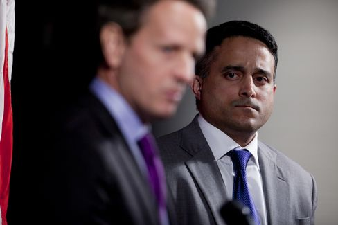 Raj Date, then associate director for research, markets and regulations at the Consumer Financial Protection Bureau (CFPB), right, looks on as Timothy Geithner, then U.S. treasury secretary, speaks at the CFPB in Washington, D.C. on Dec. 1, 2011. Photographer: Andrew Harrer/Bloomberg