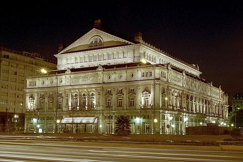 The illuminated exterior of the Teatro Colon