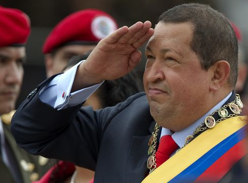 Venezuelan President Hugo Chavez salutes during a military parade to commemorate the 20th anniversary of his failed coup attempt, in Caracas on Feb. 4, 2012. Photographer: Juan Barreto/AFP/Getty Images