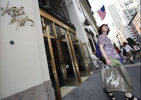 A shopper leaves a Lord & Taylor store