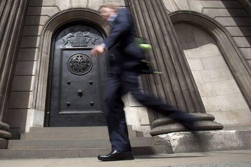A Pedestrian Passes The Bank of England