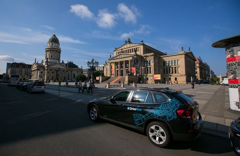 A DriveNow car parked outside the Konzerthaus in Berlin. Photographer: Krisztian Bocsi/Bloomberg