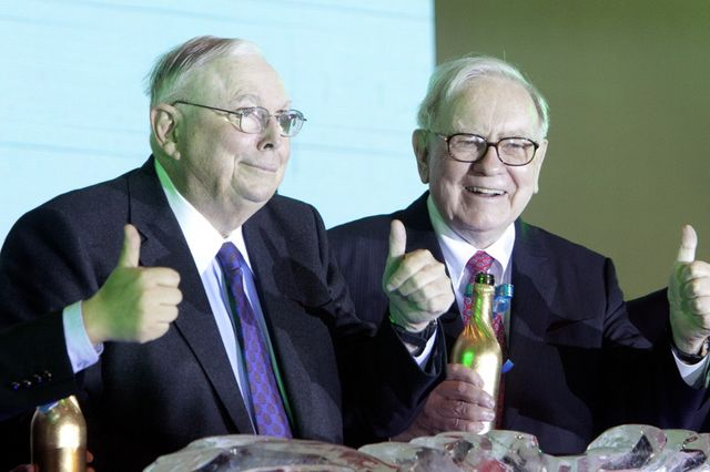 Let's hope Charles Munger, left, understands what's going on at a little newspaper publisher where he's the chairman. Photographer: Nelson Ching/Bloomberg