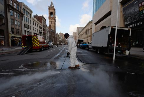 A cleaning crew steam washes Boylston Street across from the blast site near the Boston Marathon finish line one week after the FBI handed it back to the city in Boston on April 22, 2013. Photographer: Kevork Djansezian/Getty Images