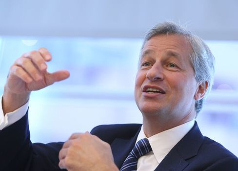 Dimon Widens Gap With JPMorgan Bankers as Wall Street Pay Slides