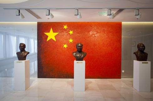 Busts of Chen Yun, former Chinese Communist Party (CCP) leader, left, Mao Zedong, former leader of China, center, and Deng Xiaopeng, former leader of China, sit on display in the lobby of one of China Development Bank Corp.'s (CDB) offices in Beijing, China. Photographer: Nelson Ching/Bloomberg