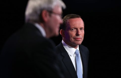 Tony Abbott, Australia's opposition leader, right, and Prime Minister Kevin Rudd during the Leaders Debate at the National Press Club in Canberra, Australia. Photographer: Gary Ramage-Pool/Getty Images