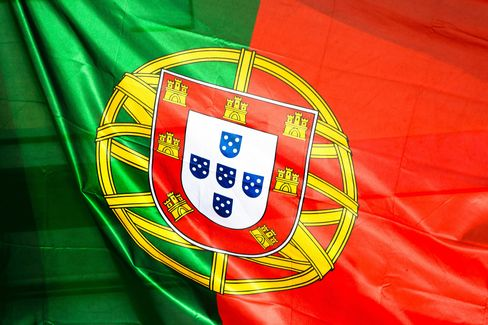 The Portuguese National Flag Hangs from a Store in Lisbon