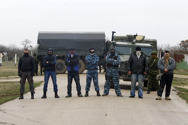 Armed men and armored vehicles blocked Ukrainian army forces from approaching the Belbek military airport on Tuesday. Photographer: Bulent Doruk/Anadolu Agency/Getty Images