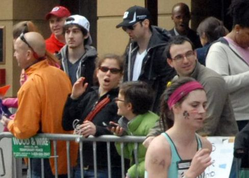 This April 15, 2013 photo provided by Bob Leonard shows second from left, Dzhokhar A. Tsarnaev, who was dubbed Suspect No. 2 and third from left, Tamerlan Tsarnaev, who was dubbed Suspect No. 1 in the Boston Marathon bombings by law enforcement. This image was taken approximately 10-20 minutes before the blast. Photographer: Bob Leonard/AP Photo