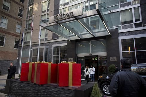 Guests Exit a Hilton Hotel in New York