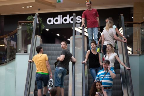 Adidas Cuts Forecasts After Quarterly Profit Misses Estimates