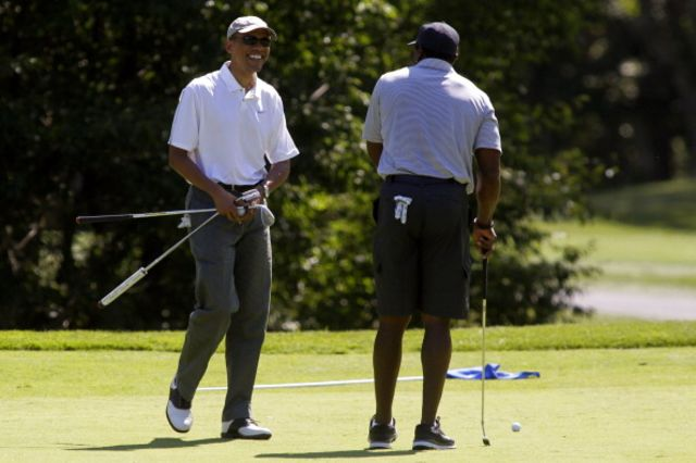 President Barack Obama andAhmad Rashad, presumably not talking about Syria.