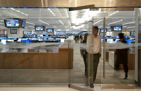 Traders exit the Wells Fargo & Co trading floor in Charlotte, North Carolina. Photographer: Davis Turner/Bloomberg