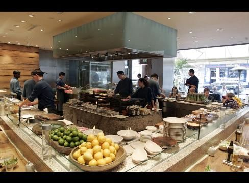 Chefs work in the kitchen of Roka