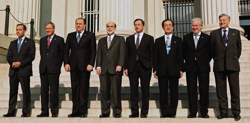 The Group of Seven central bankers pose for a group photo in front of the U.S. Treasury in Washington. Photographer: Chris Kleponis/Bloomberg