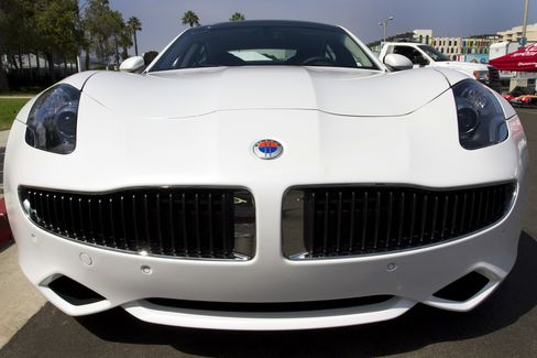 The front of a Fisker Karma luxury plug-in hybrid. The only exterior misfire is the ridiculous grill, which is shaped like a French waiter's pencil mustache. Photographer: Jonathan Alcorn/Bloomberg