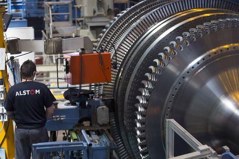 An Alstom SA employee Works On A Turbine Unit In Belfort