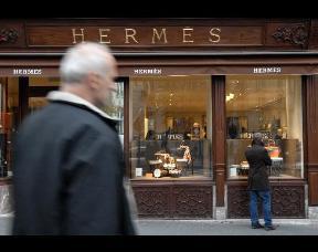 A shopper browses a Hermes store in Paris
