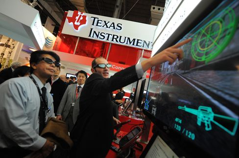 Chipmaker Texas Instruments are among companies that have lowered their guidance because of faltering demand. Photographer: Denis Doyle/Bloomberg