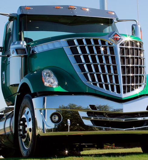 Christie Covets Illinois Jobs as Deere Digs to Pay Tax Incre