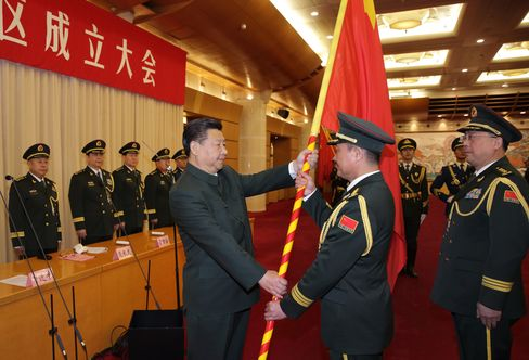Xi Jinping confers military flags on the five newly-established theater commands of the PLA.