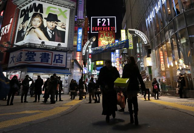 A sales-tax increase will put the squeeze on Japan's shoppers. Photographer: Yuriko Nakao/Bloomberg