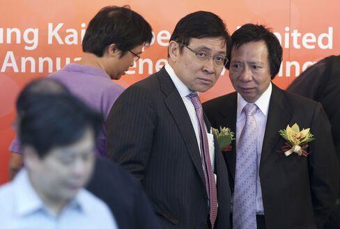 Sun Hung Kai Co-Chairmen Thomas and Raymond Kwok