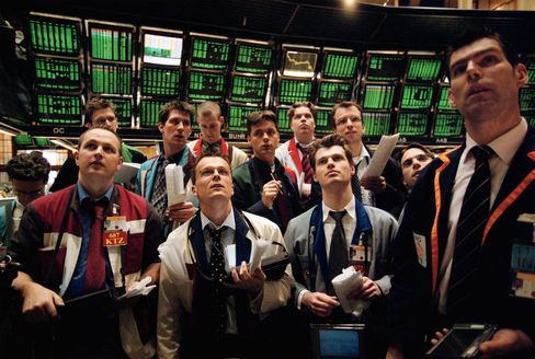 Former Nidera NV Trader Lars Van der Laan, center, is seen holding a pencil as he  worked on the floor of the European Option Exchange in Amsterdam in 2002. Van der Laan, 37, is now earning about 20 percent of what he used to as a power trader. Credit: Peter Hilz via Bloomberg